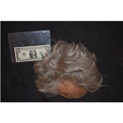 SEVERED SILICONE SCALP WITH HAND PUNCHED GRAY HAIR