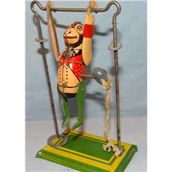 "Tin swinging monkey windup toy, 7"" h"