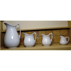 "4 Ironstone pitchers, 4"" to12"", not matching"