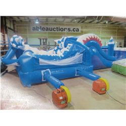INFLATABLE ICE CASTLE MEASURES APPROX 28FT X 13FT  X  10FT HAS SEAM LEAK (INCLUDES 1 PUMP)