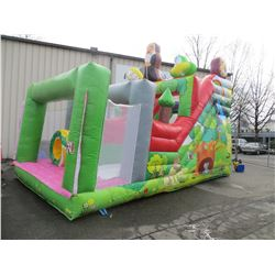 INFLATABLE JUNGLE THEME  OBSTACLE COURSE MEASURES 23' X 12' X 16' INCLUDES 2 PUMPS