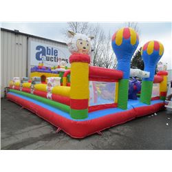 INFLATABLE ADVENTURE PLAYGROUND WITH CASTLES MEASURES 25'W X 33'L X16'H INCLUDES 2 PUMPS