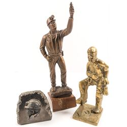 Three Mining Sculptures: Bronze Miner, Brass Miner, and Miner's Face Carved in Rock
