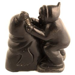 Eskimo Grabbing Walrus by Its Tusks Sculpture, Noah Tuki