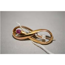 Antique 14kt yellow gold infinity style brooch, set with 0.08ct Old European cut diamond and oval sh