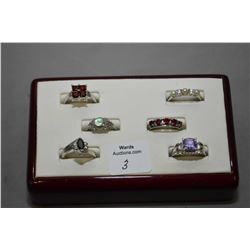 Six sterling silver rings all set with gemstones