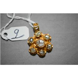 Ladies 18kt yellow gold pendant set with center 0.20ct rose cut polki diamond and six 0.05ct rose cu