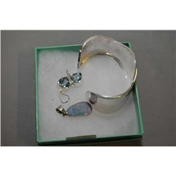 Selection of brand new sterling silver including hammered bangle, blue topaz heart shaped earrings a