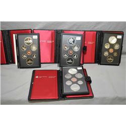 Four Royal Canadian Mint double dollar proof sets including a 1981 Canadian Railway set, 1983 Univer