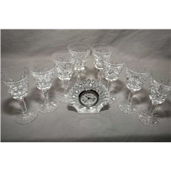 Eight signed Waterford sherry glasses plus a small shell motif Waterford clock
