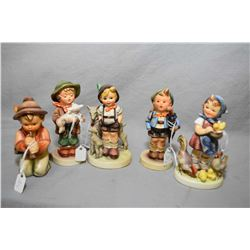 "Five assorted Hummel and Goebel figures including ""Little Goat herder"", ""Feeding Time"" etc."