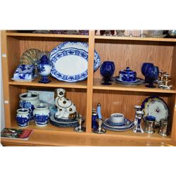 Two shelf lot of collectibles including several pieces of Flow blue, Imari candlesticks, Staffordshi