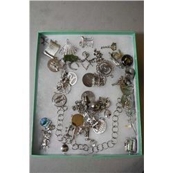 Selection of sterling silver and silverplate charms including bracelets