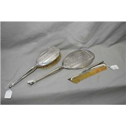 British sterling dresser set with hand mirror, brush and comb slide