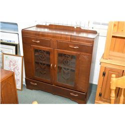 Waterfall style walnut sideboard with two glazed display doors and four drawers including one fitted