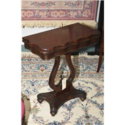 Antique mahogany fold over occasional table with lyre pedestal