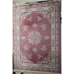 100% wool area rug with cherry blossom border, center medallions in shades of soft rose with blue an