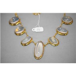 10kt yellow gold necklace set with seven oval shaped bezel set cabochon opal gemstone. Retail replac