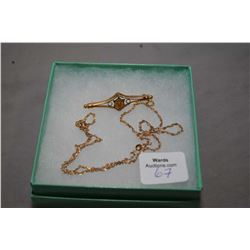 "Ladies 10kt yellow gold 19"" neck chain and a 15kt yellow gold brooch"