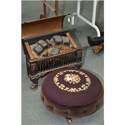 Vintage electric faux fire with glass embers and a small needlepoint upholstered stool