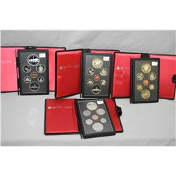 Four Royal Canadian Mint double dollar proof sets including a 1980 Artic land transfer set, two 1982