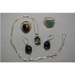 Selection of sterling and silver jewellery including sterling ring set with tiger's eye, sterling bo