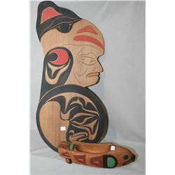 Two hand carved and handpainted West Coast Haida pieces including figural wallhanging and a handcarv