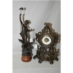 Spelter statue on a wooden plinth and a cast figural clock, not working at time of cataloguing