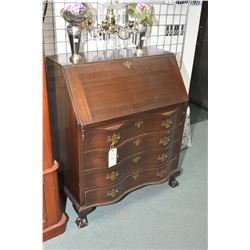 Mid 20th century serpentine front mahogany drop front secretaire with fitted interior and ball and c