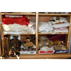 Two shelf lots of collectibles including vintage linens, fringing and curtain rail finials etc.