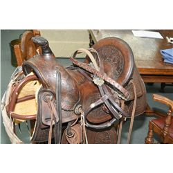 Antique highback western saddle with show bridle and reigns