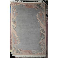 "Sculpted wool area rug in shades of mauve, soft and teal, 48"" X 72"""