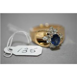 Ladies 14kt yellow gold, blue sapphire and diamond cluster ring, set with 0.36ct of brilliant round