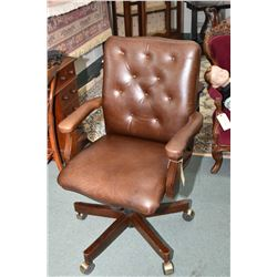 Leather upholstered swivel open arm office chair with button tufted back