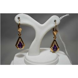 Ladies 14kt yellow gold earrings set with amethyst and diamond gemstones