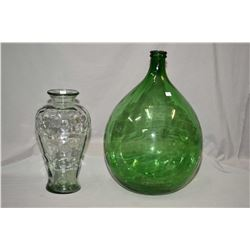 "Large green glass bottle 26"" in height and a clear glass flower vase"