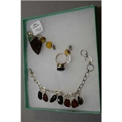 Selection of brand new sterling silver including red cherry amber pendant, bracelet and ring plus a