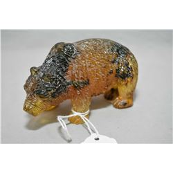 "Carved yellow gold Amber grizzly bear, 4"" in length and 1 1/2"" wide"