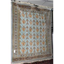100% wool area carpet with mulitple borders, geometric designs in shades of teal, cream and browns,