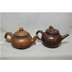 "Purple clay ""Root top"" stamped teapot and a purple clay teapot incised ""Silent Spring"" both pots are"
