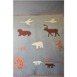 Inuit wool wallhanging featuring geese, walrus and elk plus polar bear and hunters with dogs sewn ar