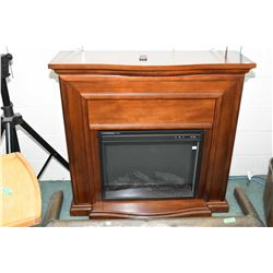 Modern electric fireplace with remote, working at time of cataloguing