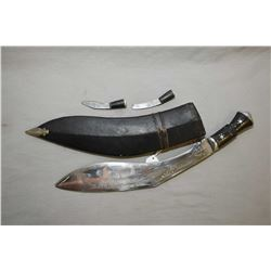 East Indian Kukri in leather sheath with two smaller daggers