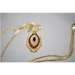 Ladies 14kt yellow gold pendant with marquise shaped cluster, set with 1.44cts of Almandite garnets