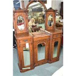 Antique petite size Victorian side board with three mirrored doors, large center mirror, two bevelle