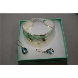 Sterling silver hammered bangle and a pair of blue topaz gemstone earrings