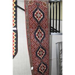 100% wool runner with mulitple medallions, overall geometic and triple border in shade of red, blues