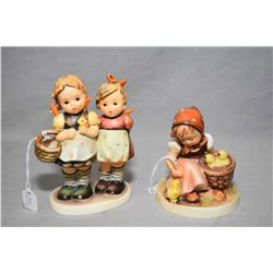 "Two Goebel Hummel figures including ""Daddy's Girls"" and girl feeding chicks with full bee mark"