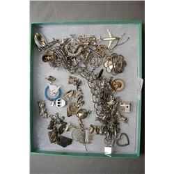 Selection of sterling silver and silverplate charms including bracelet