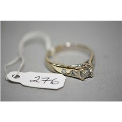 Ladies 14kt white gold and diamond ring set with 0.50ct princess cut and 0.28cts of brilliant white